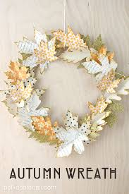 use cut paper leaves to create an autumn wreath
