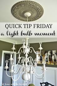 quick tip friday changing out light bulbs to update the chandelier
