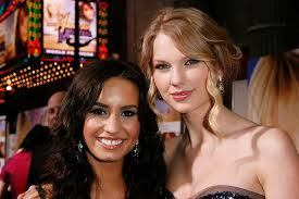 demi lovato then and now 2013. hollywood - april 02: actress demi lovato (l) and singer taylor swift arrive then now 2013 o