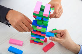Game Played With Wooden Blocks Businessmen playing wooden blocks game Stock Photo © gioiak100 92