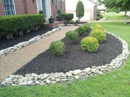 decorate your garden with river rock landscaping
