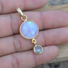 natural blue fire rainbow moonstone pendant solid sterling silver gold overlay blue topaz pendant