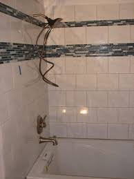 bathtub faucet and shower head. why does my shower head drip when the tub faucet is on? bathtub and