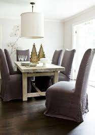 grey and white upholstered chairs. dining room. interactive image of room decoration using small brown christmas tree table grey and white upholstered chairs