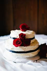 Buttercream Wedding Cake With Red Roses And Black Ribbon