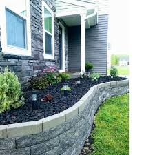 raised flower bed in front of house