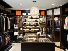 Boutique Walk-In Closet Features Custom Storage 6 Photos