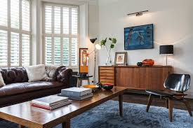 mid century eclectic living room blue armchairs combined red painted wall white modern rug lounge mid century modern rugs blue c29 century