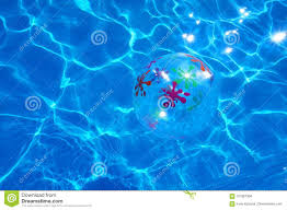 swimming pool beach ball background. Download Beach Ball Floating In A Blue Swimming Pool. Summer Background.  Stock Photo - Swimming Pool Beach Ball Background