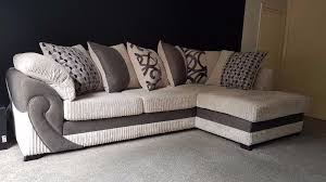 dfs illusion corner sofa bed with pillow back cushionatching footstool