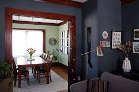 Natural Wood Trim And A Jade Green Dining Room Contrast With Desaturated Navy Walls Benjamin