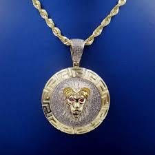 10k yg lion head pendant