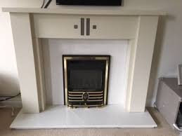 lovely wooden fireplace surround and marble granite hearth backboard