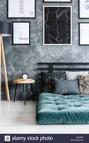 Futon Interior Design Clock On Wooden Table Next To A Green Futon Against Concrete