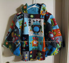 some people also like to cut a line straight up the back of the poncho to make it easier to put the child in the car seat