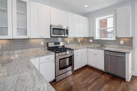 Subway Glass Tiles For Kitchen White Cabinets And Counter Completed With Marble Countertop Glass