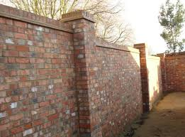 Small Picture Walled Garden Brick wall with two brick piers and on edge brick
