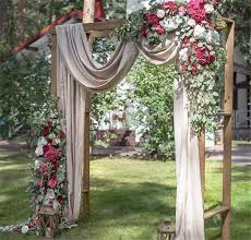 beautiful wedding ceremony backdrop arbor with d flowers and lantern accents