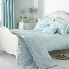 soft blue curatin with fl pattern plus white wooden bed with blue bedding set placed on