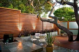 Elegant Wooden Fences For Modern Japanese Patio Using LED Outdoor Lighting  Ideas And Grey Stone Tiled Deck