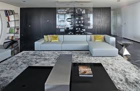 office rugs light grey l shaped leather floor couch and huge area rug in minimalist modern