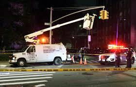 Light Falls On Reporter Worker In Cherry Picker Fixing Nyc Traffic Light Falls To
