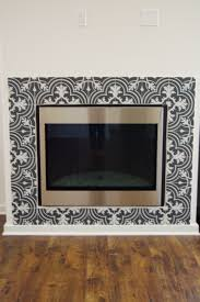 black and white patterned ceramic tile merola twenties mosaic fireplace surround