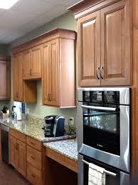 microwave wall oven duo built into cherry cabinets with raised panel doors