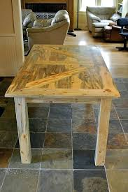 barn door table barn door the beetle kill pine top on this table sits on heavy barn door table do it yourself