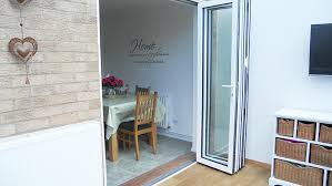 bi fold doors from house to a conservatory in white