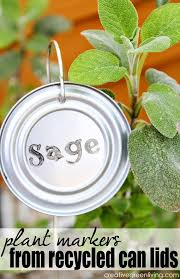 how to make stamped plant markers with recycled can lids vegetable garden