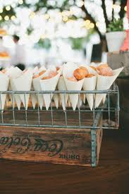 paper cones wedding. picture of display donuts in paper cones and wire stands for a rustic wedding n