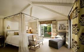 Romantic master bedroom with canopy bed Relaxing French Doors And Canopy Bed Add Romantic Touch To The Master Bedroom Source Lauren Greutman French Doors And Canopy Bed Add Romantic Touch To The Master