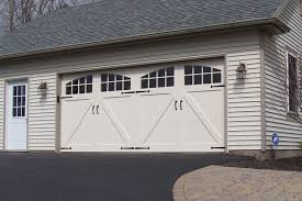 roll up garage doors that look like barn wood carriage house