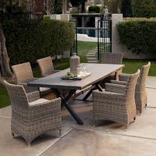 hampton bay patio furniture with wicker dining chairs and dark dining table plus cozy concrete flooring