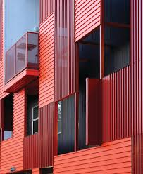 the corrugated lines of the panels are juxtaposed in alternating horizontal and vertical directions creating an intricate patchwork out of just two colors