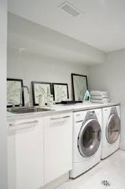 cabinets laundry room. peter fallico - clean, modern laundry room! white ikea cabinets, framed botanical, prints, chrome fixtures and soft gray green walls. cabinets room