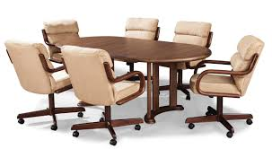 livingroom dining chairs with wheels and arms room casters dinette sets reviews wood leather cross