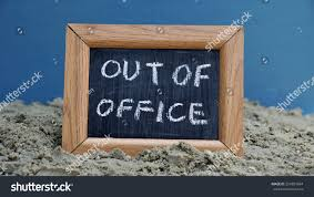 office chalkboard. Out Of Office Written On A Chalkboard At The Beach R