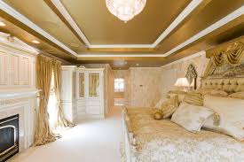 gold bedroom furniture. gold bedroom with custom window treatments and bedding traditional-bedroom furniture d