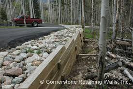 timber retaining wall built to support the asphalt driveway view large picture