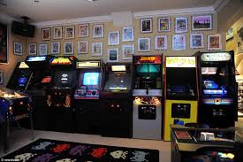 row of arcade machines with space invaders rug