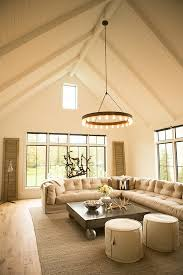 industrial living room features a paneled cathedral ceiling accented with a ralph