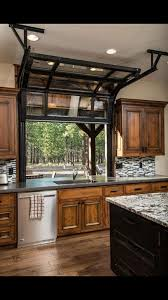 Glass Garage Doors Kitchen Of A Beautiful Indooroutdoor Space Full View Intended Models Design