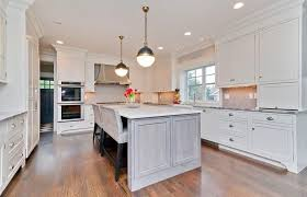 luxury white cabinet kitchen with white counter island and two bench breakfast bar dining area