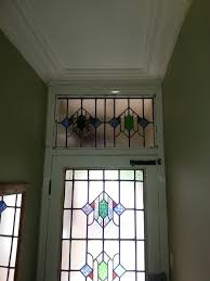 stunning stained glass door and matching transom