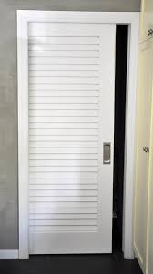 white wooden sliding louvered doors home depot with silver handle for home door idea
