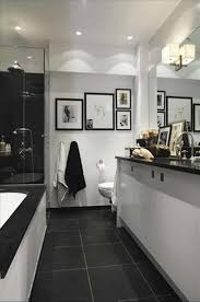 Dark Floor Tile Bathroom With Dark Floor Tiles And White Walls And Recessed