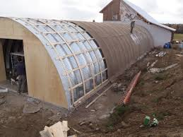 Buried quonset hut root cellar by Endeavour Centre