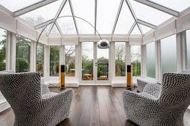 ... Conservatory for London home with plush seating [Design: Inspired  Dwellings]